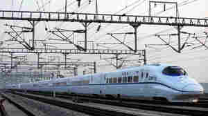 WIDE: The high-speed train travels through Wuhan city in central China.  Shi wei/AP