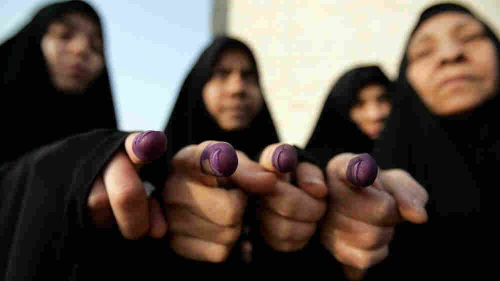 WIDE: Iraqi women show ink-stained fingers after voting in Iraq's 2009 election. Alaa al-Marjani/AP