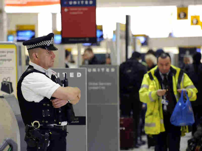 A British police officer stands guard at Terminal 1 of London's Heathrow Airport.