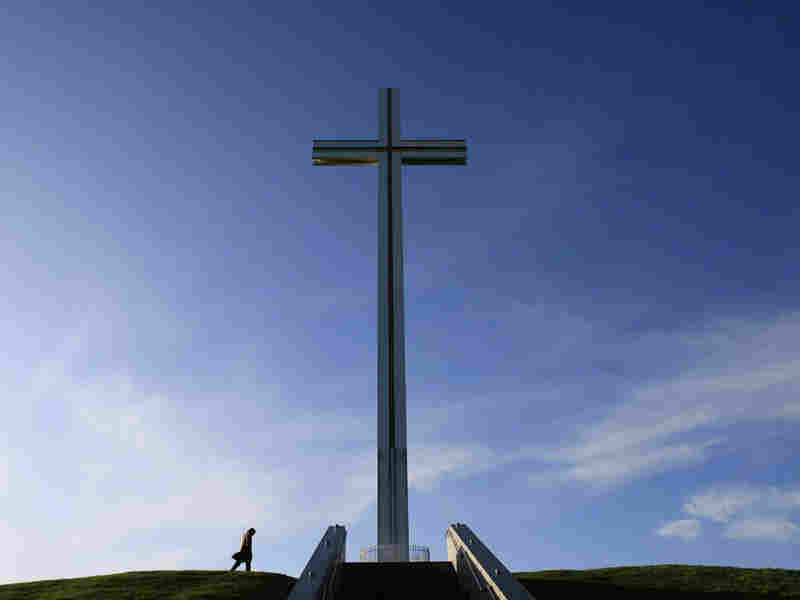 A man walks past the Papal Cross in Dublin.
