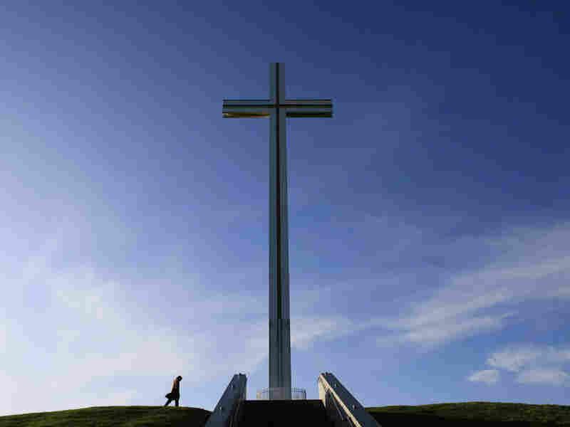 A man walks past the Papal Cross in Dublin.