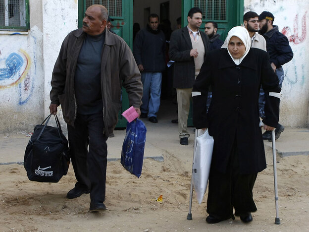 Palestinians arrive to cross into Egypt through the Rafah border crossing in the southern Gaza Strip on Sunday.