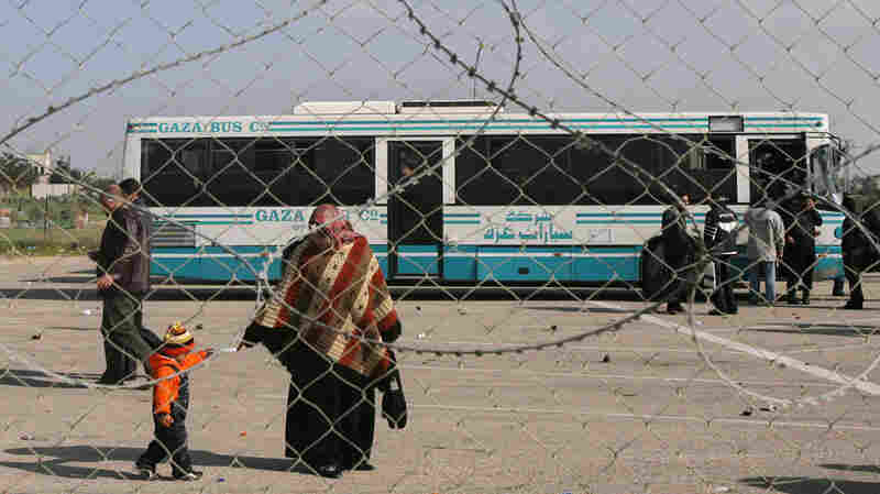 Palestinians wait to cross the Rafah border crossing between the Gaza Strip and Egypt.
