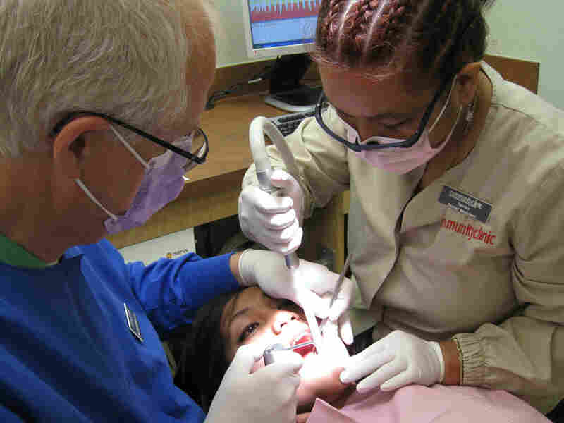 A Marshallese teenager gets her molars sealed at a community health clinic.