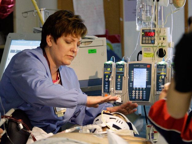 A nurse tends to a patient at the University of Maryland Medical Center in Baltimore. The Bureau of Labor Statistics says nursing is the occupation that will provide the most new jobs over the next decade. (AP)
