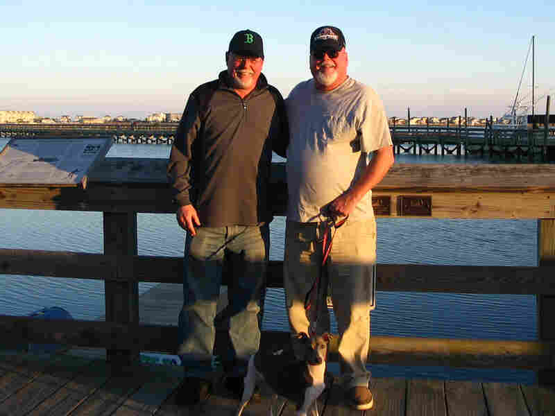 Tim and Paul Daly stand on a dock.