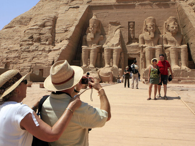 Tourists take pictures of the temple of Abu Simbel, south of Aswan, Egypt, in 2008.