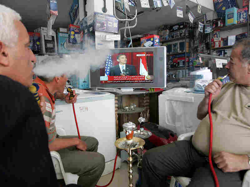 Palestinians watch a broadcast of President Obama's June 4 speech.