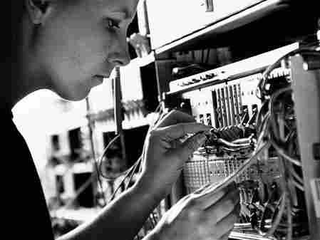A technician checks a networking cable.