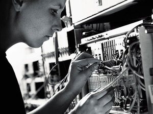 A technician checks a networking cable.