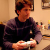 Todd Howard, the game director for Bethesda Softworks, plays Fallout 3 in his office.