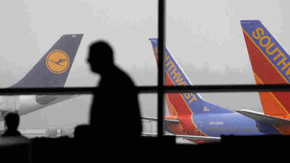 A passenger walks past waiting jets at Seattle-Tacoma International Airport on Jan. 4.