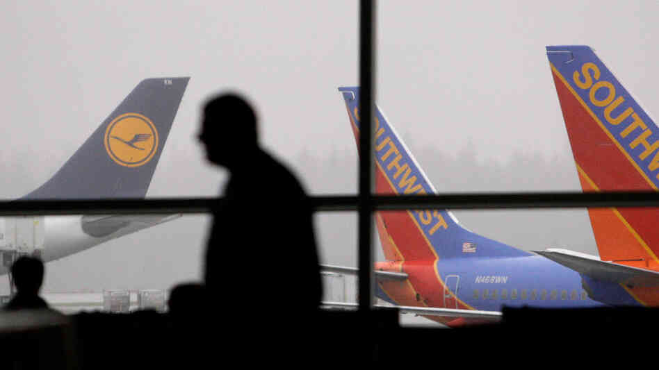 A passenger walks past waiting jets at Seattle-Tacoma International Airport on Jan. 4.