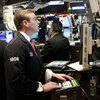 Traders watch market activity at the New York Stock Exchange on Monday.