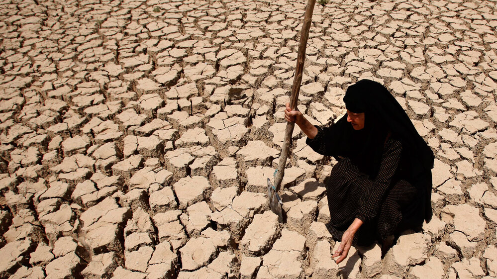 Adilla Finchaan, 50, checks her drought-stricken land in Latifiyah, about 20 miles south of Baghdad, in this photo taken in July 2009. Below-average rainfall and insufficient water in the Euphrates and Tigris rivers — something the Iraqis have blamed on upstream dams in Turkey and Syria — have left Iraq bone-dry for a second straight year.