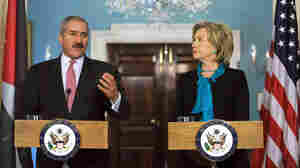 W: Clinton listens to remarks by Jordanian Foreign Minister Nasser Judeh