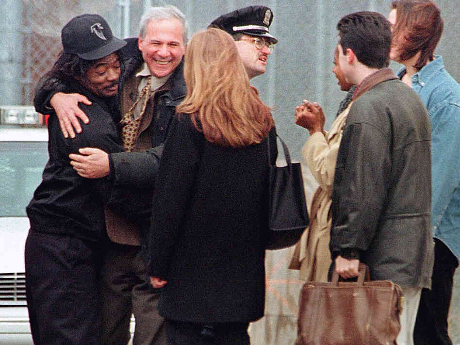 David Protess (right) and Anthony Porter  embrace outside the Cook County Jail in Chicago.