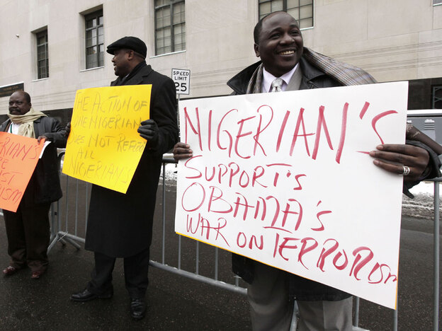Nigerian-Americans, including Follisito Ogunfiditimi (right) stand Friday outside the Theodore Levin United States Courthouse in Detroit. Many in the Nigerian-American community are shocked that the man accused of trying to blow up a Detroit-bound plane on Christmas Day is from Nigeria.