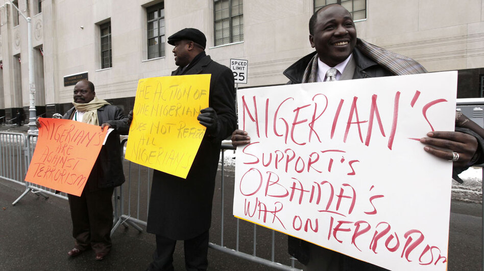 Nigerian-Americans, including Follisito Ogunfiditimi (right) stand Friday outside the the Theodore Levin United States Courthouse in Detroit. Many in the Nigerian-American community are shocked that the man accused of trying to blow up a Detroit-bound plane on Christmas Day is from Nigeria.