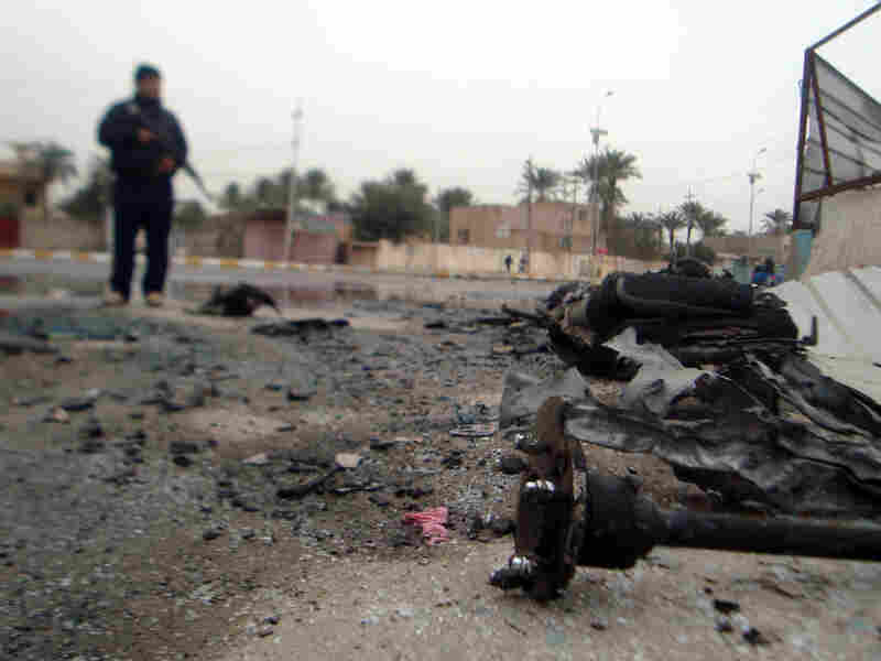 Debris litters the road after two bombings in the western city of Ramadi, Dec. 30, 2009