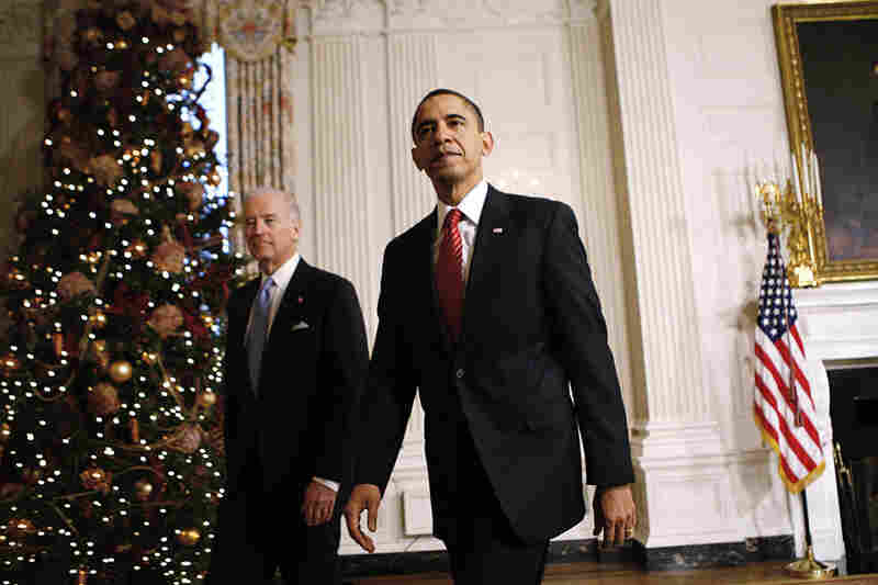 President Obama and Vice President Biden leave the White House dining room on Dec. 24.