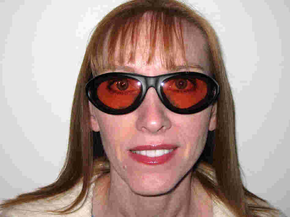 Paula Cofer wears protective goggles due to complications with Lasik.