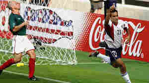 Landon Donovan, of the U.S. soccer team, scores a goal during a 2002 World Cup match against Mexico.