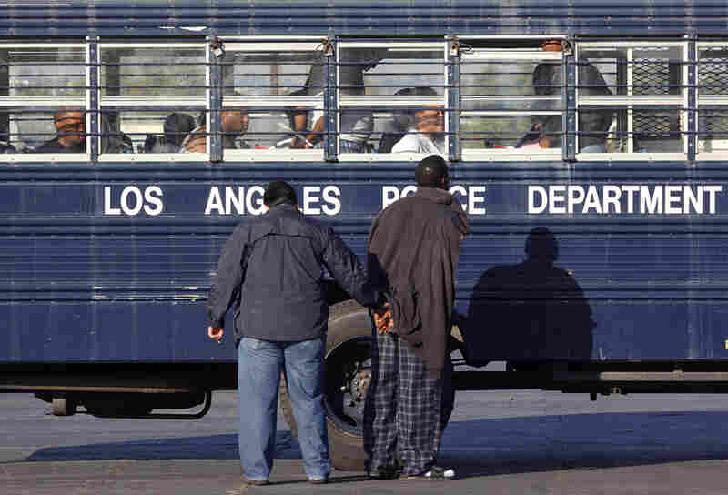 Los Angeles police and FBI agents process detained suspected gang members in October 2009.