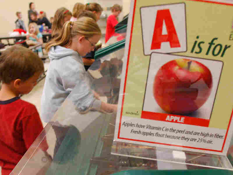 Students get lunch at the salad bar as part of a health program.