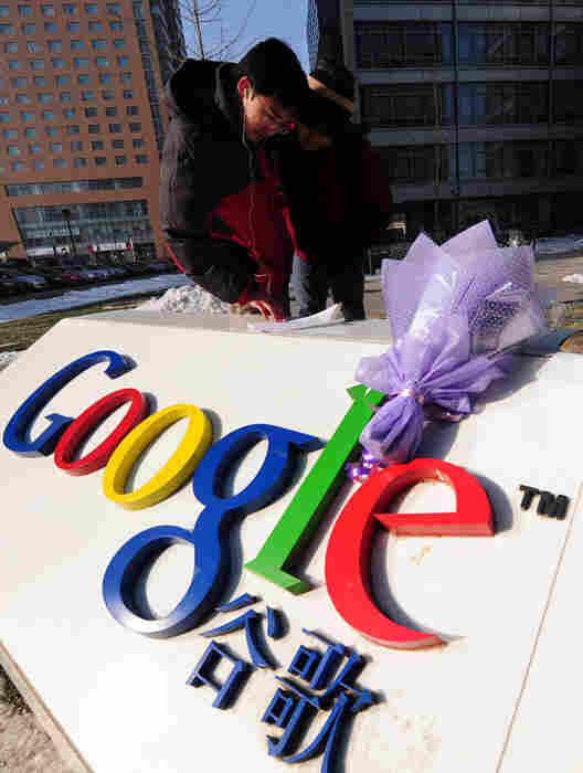 A bouquet of flowers lies upon the Google logo outside the company's Beijing headquarters.