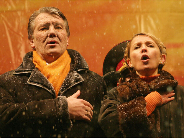 Viktor Yushchenko and onetime political ally Yulia Tymoshenko sing the Ukrainian national anthem in Kiev's central Independence Square in November 2004, during protests that became known as the Orange Revolution and that led ultimately to Yushchenko's election.