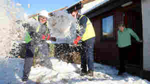 Clearing snow in Scotland. Andrew Milligan/AP