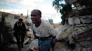 A Haitian rescue worker helps the L.A. County Search and Rescue team in in downtown Port-au-Prince.