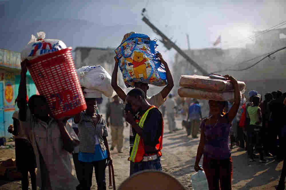 Haitians Carry Remaining Belongs Through Street