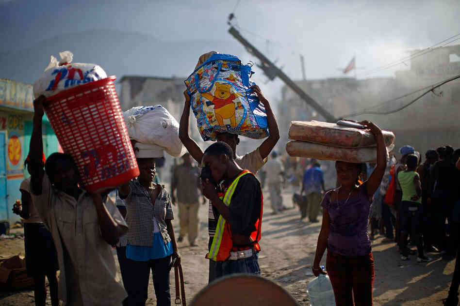 Haitians Carry Remaining Belongs Through Street