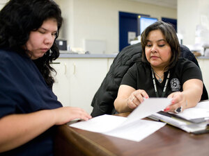 Officer Sylvia Urrutia interviews Dominica Esparza for Lubbock's pre-trial release program.