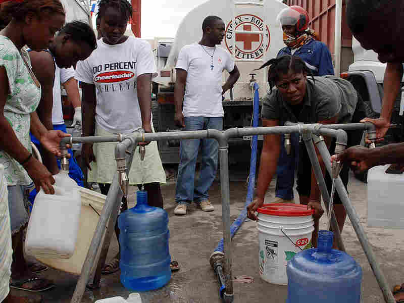 Red Cross distributes water in Port-au-Prince