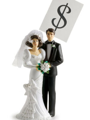 Wedding cake topper with a dollar sign