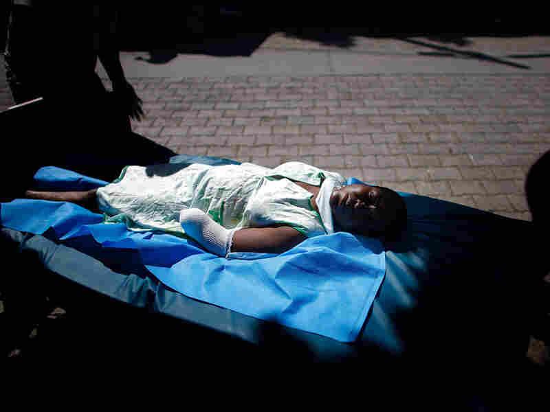 Girl on a stretcher, Haiti
