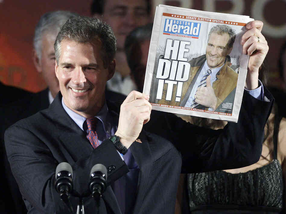 Massachusetts state Sen. Scott Brown (R-Wrentham) holds up a copy of the 'Boston Herald.'