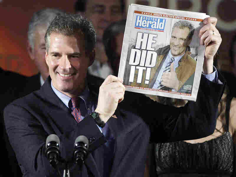 Massachusetts state Sen. Scott Brown (R-Wrentham) holds up a copy of the 'Boston Herald.'