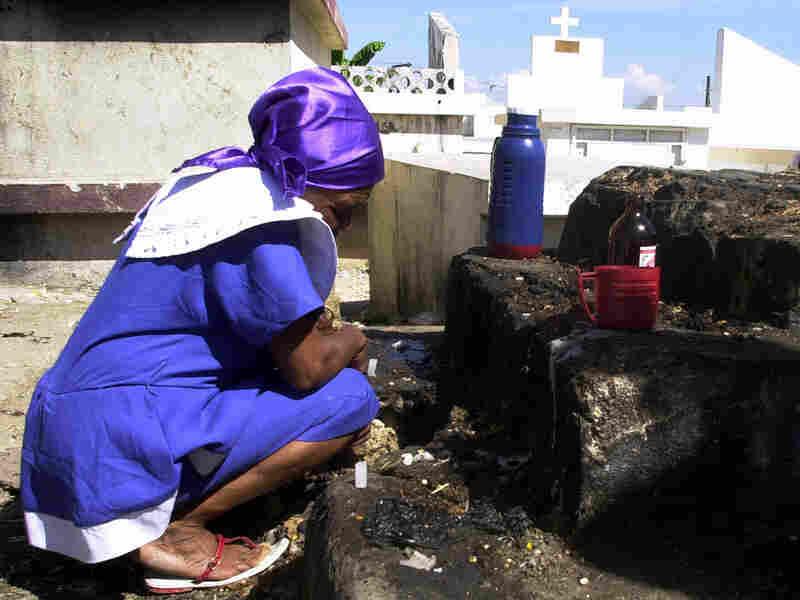 A Haitian woman observes a moment of silence.
