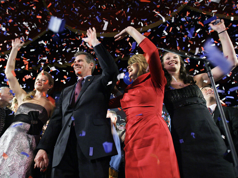 Massachusetts senator-elect Scott Brown waves with his wife, Gail Huff, and their daughters, Arianna (left) and Ayla, during his victory party Tuesday in Boston.