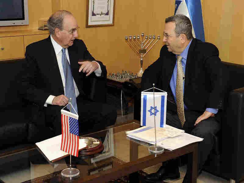 George Mitchell (left) meets Israeli Defense Minister Ehud Barak
