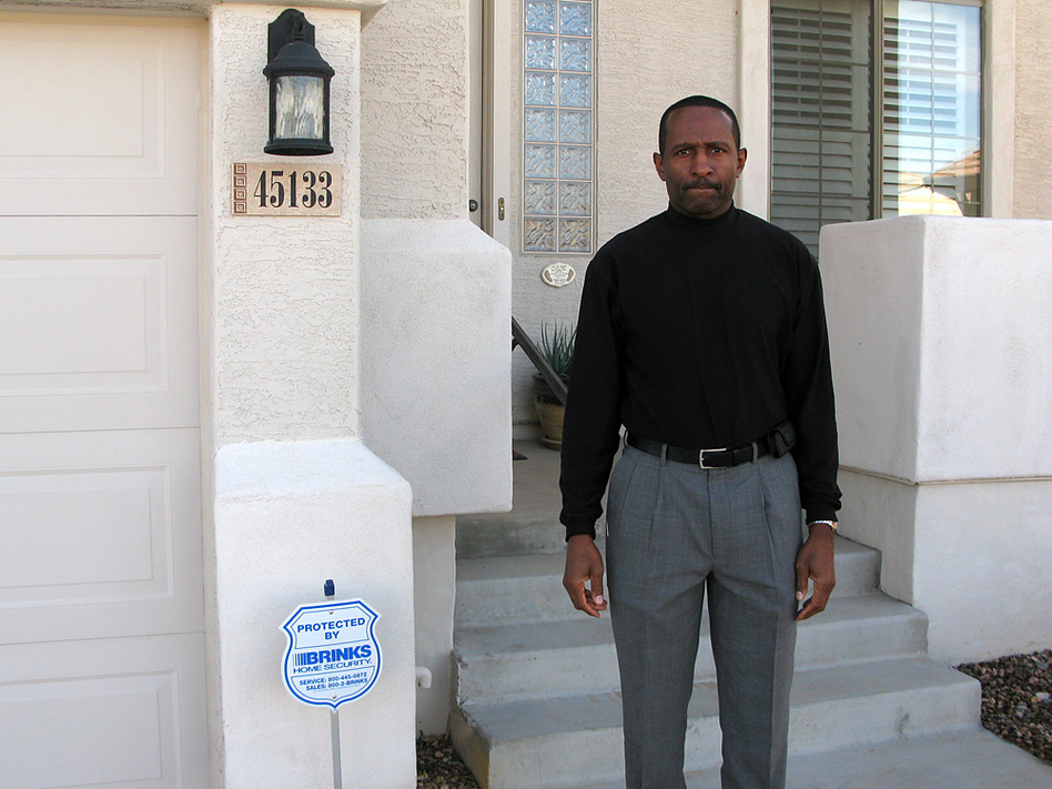 Thad Salter stands in front of the home he bought for $300,000 in 2006. The house in Maricopa, Ariz., is now appraised at $125,000.