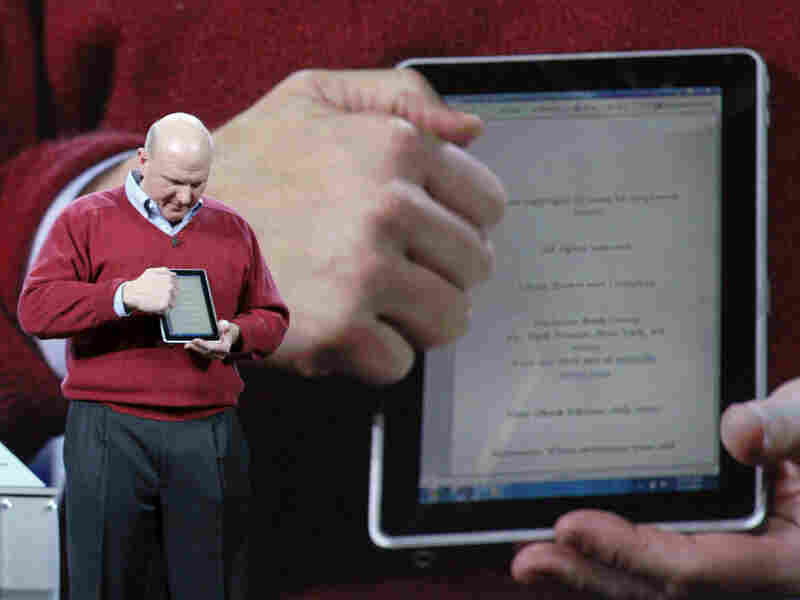 Microsoft CEO Steve Ballmer demonstrates HP's slate tablet.