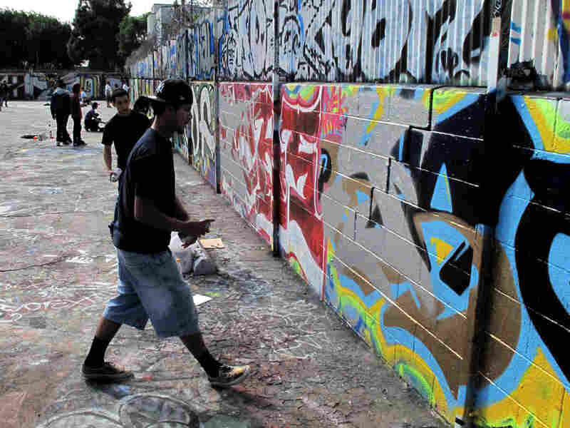 One of the stops on the tour is the Pico Union Graffiti Lab, where taggers can legally spray paint.