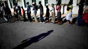 Haitians wait in line for rations from the United Nations World Food Program