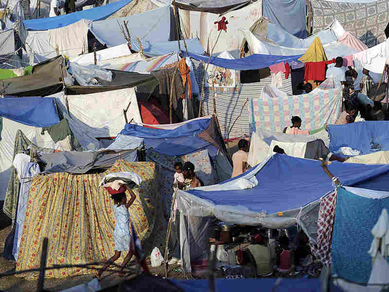 Displaced Haitians have used curtains, blankets and tarps to create large tent cities.