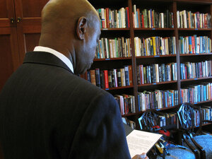 Chaplain Barry Black  reads from a prayer in his office
